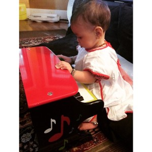Maisie, my miracle ubiquinol baby, playing her piano at 9 months