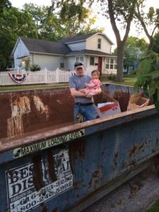 Maisie and R inspecting the dumpster