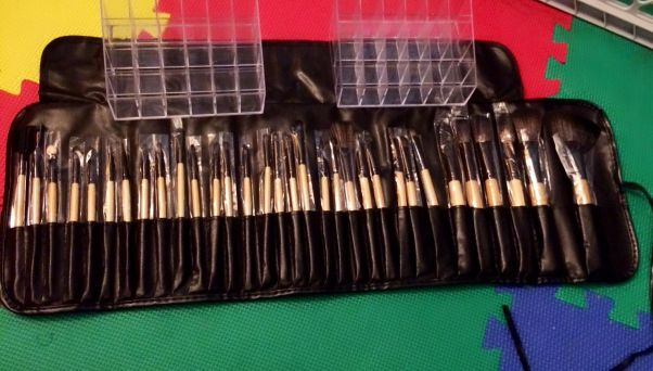 my actual haul: 32 piece kabuki makeup brush kit for $12 BUCKS and 2-24 compartment acrylic lipstick organizers for 3 bucks EACH!