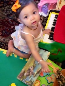 Jamming out, because she heard her pianist brother doing so from his real piano