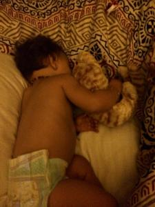 Nothing sweeter than a baby cuddling her stuffed kitty in her sleep