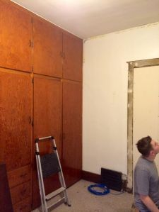 walls ready for drywall over the plaster- the former door once lead to the downstairs bathroom
