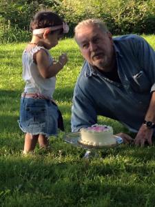 she liked the cake part, especially when she got to feed papa